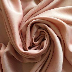 Tissu crêpe, peau de pêche – corail